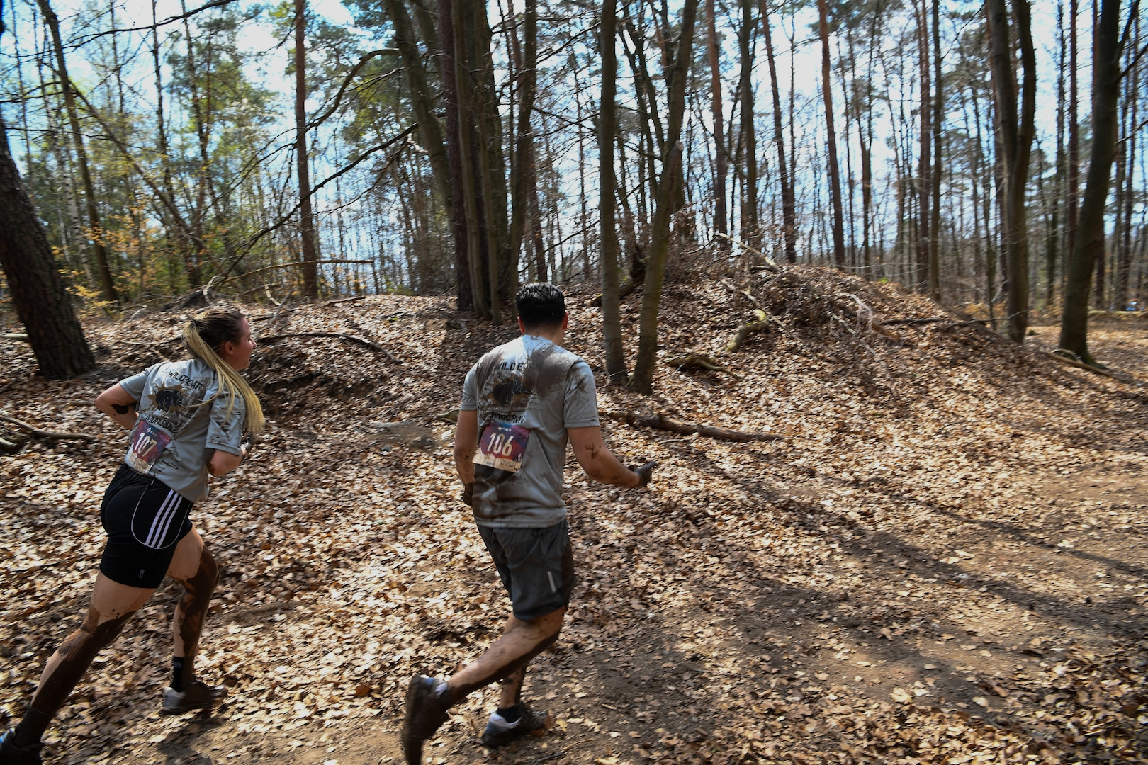 Airman run in the mud.