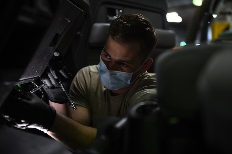 Airman 1st Class Korey Sarantopoulos, 31st Logistics Readiness Squadron vehicle maintenance technician, repairs a government vehicle at Aviano Air Base, Italy, April 20, 2021. Sarantopoulos repaired the heat, ventilation, and air conditioning system of a Ford F-150 truck. The 31st LRS delivers and sustains combat logistics readiness support through professional vehicle, supply and fuels management. (U.S. Air Force photo by Senior Airman Ericka A. Woolever)