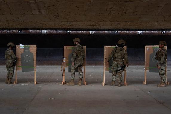 Four Airmen check targets at gun range