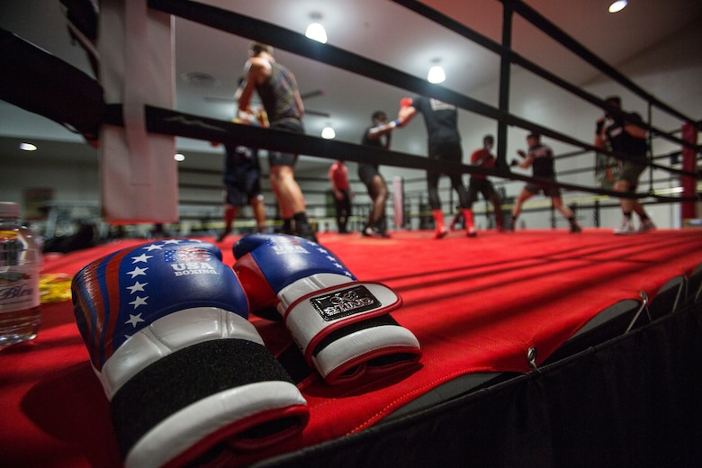 A pair of gloves are placed outside the boxing ring during a training session for U.S. Marine Corps boxers on Marine Corps Base Camp Lejeune, N.C., April 20.