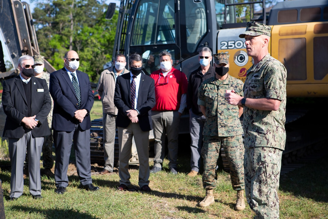 U.S. Navy Capt. Jim Brown, commanding officer, Office in Charge of Construction Florence addresses staff and attendees during a ground-breaking ceremony for the hurricane recovery and military construction projects at Marine Corps Base Camp Lejeune, North Carolina, April 22, 2021.  The ground-breaking ceremony marked the first of seven military construction project packages to replace facilities on MCB Camp Lejeune, Marine Corps Air Station New River and MCAS Cherry Point damaged by Hurricane Florence in September 2018. (U.S. Marine Corps photo by CWO2 Brian Lautenslager)