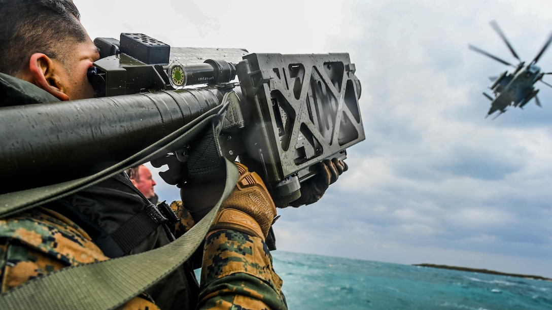 A U.S. Marine aims an FIM-92 Stinger missile on a combat rubber raiding craft on Ukibaru, Japan, Feb. 18.