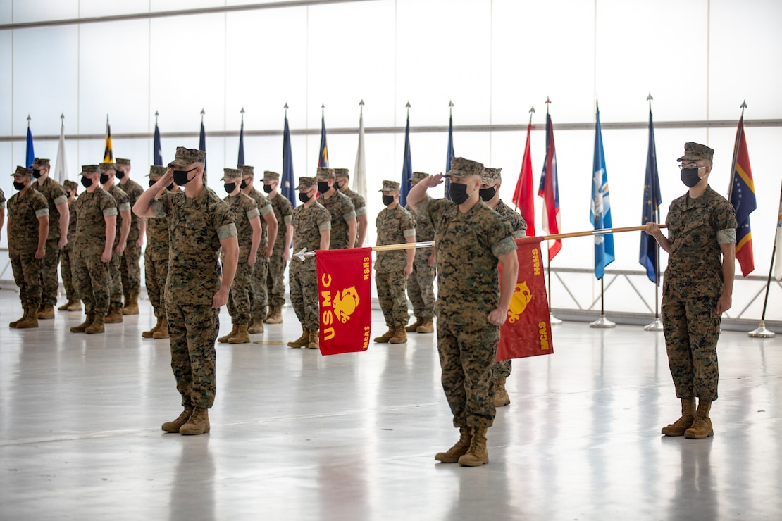 U.S. Marines salute during the playing of the National Anthem at the Marine Corps Air Station New River sergeant major relief and appointment ceremony at the Center for Naval Aviation Technical Training on MCAS New River, North Carolina, April 16, 2021. The relief and appointment ceremony symbolized the passing of responsibilities and duties from Sgt. Maj. Carlos A. Orjuela to the incoming sergeant major, Sgt. Maj. Douglas W. Gerhardt. (U.S. Marine Corps Lance Cpl. Isaiah Gomez)