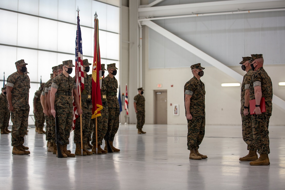 U.S. Marine Corps Sgt. Maj. Carlos A. Orjuela, the outgoing sergeant major, Marine Corps Air Station New River stands at attention during the New River sergeant major relief and appointment ceremony at the Center for Naval Aviation Technical Training on MCAS New River, North Carolina, April 16, 2021. The relief and appointment ceremony symbolized the passing of responsibilities and duties from Orjuela to the incoming sergeant major, Sgt. Maj. Douglas W. Gerhardt. (U.S. Marine Corps Lance Cpl. Isaiah Gomez)