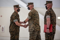 U.S. Marine Corps Sgt. Maj. Carlos A. Orjuela, left, the outgoing sergeant major, Marine Corps Air Station New River is awarded during the New River sergeant major relief and appointment ceremony at the Center for Naval Aviation Technical Training on MCAS New River, North Carolina, April 16, 2021. The relief and appointment ceremony symbolized the passing of responsibilities and duties from Orjuela to the incoming sergeant major, Sgt. Maj. Douglas W. Gerhardt. (U.S. Marine Corps Lance Cpl. Isaiah Gomez)
