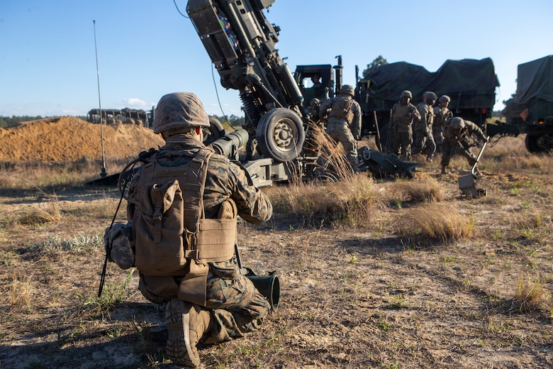 U.S. Marines with 1st Battalion, 10th Marine Regiment, 2d Marine Division (2d MARDIV), position a M777 Howitzer during Exercise Rolling Thunder 21.2 on Fort Bragg, N.C, April 19, 2021. This is a live-fire artillery exercise where 10th Marines employed distributed fires via simulated Expeditionary Advanced Bases (EAB's). The training increased 2d MARDIV's combat readiness against a peer competitor. (U.S. Marine Corps photo by Pfc. Sarah Pysher)