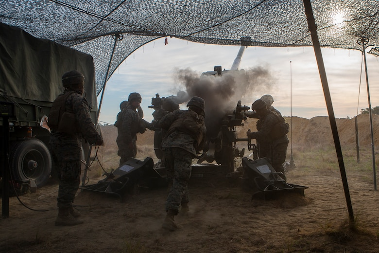 U.S. Marines with 1st Battalion, 10th Marine Regiment, 2d Marine Division (2d MARDIV), fire an M777 Howitzer during Exercise Rolling Thunder 21.2 on Fort Bragg, N.C, April 20, 2021. This is a live-fire artillery exercise where 10th Marines employed distributed fires via simulated Expeditionary Advanced Bases (EAB's). The training increased 2d MARDIV's combat readiness against a peer competitor. (U.S. Marine Corps photo by Pfc. Sarah Pysher)