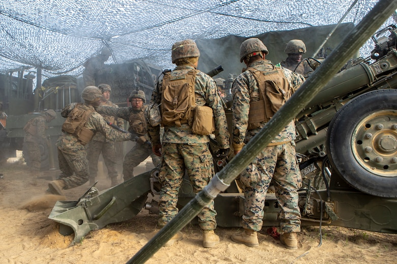 U.S. Marines with 1st Battalion, 10th Marine Regiment, 2d Marine Division (2d MARDIV), load an 155mm round into an M777 Howitzer during Exercise Rolling Thunder 21.2 on Fort Bragg, N.C, April 20, 2021. This is a live-fire artillery exercise where 10th Marines employed distributed fires via simulated Expeditionary Advanced Bases (EAB's). The training increased 2d MARDIV's combat readiness against a peer competitor. (U.S. Marine Corps photo by Pfc. Sarah Pysher)