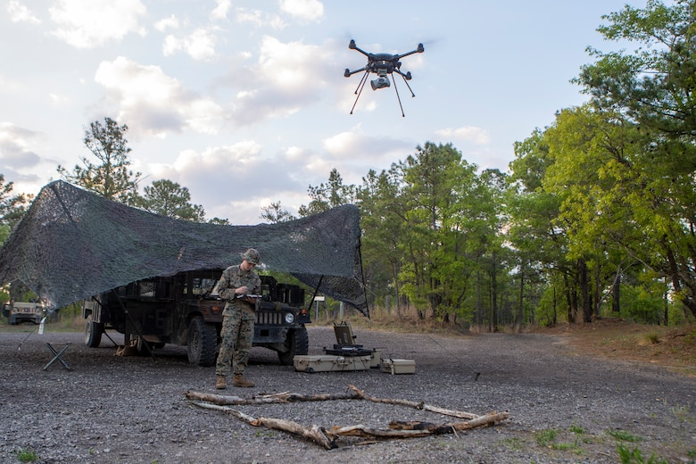 U.S. Marine Corps Lance Cpl. Jacob O'Toole, a native of Morrisonville, Ill., and an intelligence specialist with 1st Battalion, 10th Marine Regiment, 2d Marine Division (2d MARDIV), flies an R-80D SkyRaider drone during Exercise Rolling Thunder 21.2 on Fort Bragg, N.C, April 20, 2021. This is a live-fire artillery exercise where 10th Marines employed distributed fires via simulated Expeditionary Advanced Bases (EAB's). The training increased 2d MARDIV's combat readiness against a peer competitor. Small unmanned aerial systems provide increased situational awareness and act as a sensor for expediting decision making. (U.S. Marine Corps photo by Pfc.Sarah Pysher)