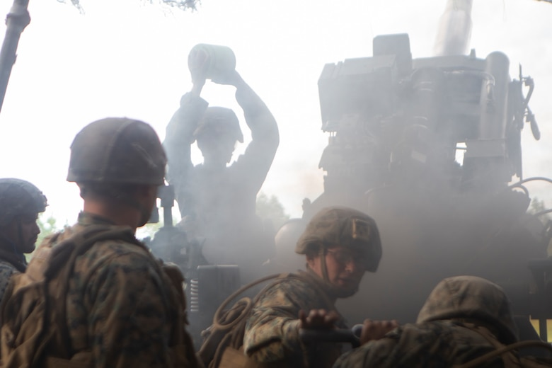U.S. Marines with 1st Battalion, 10th Marine Regiment, 2d Marine Division (2d MARDIV), prepare to fire a M777 Howitzer during Exercise Rolling Thunder 21.2 on Fort Bragg, N.C, April 25, 2021. This exercise is a 10th Marine Regiment-led live-fire artillery event that tests 10th Marines' abilities to operate in a simulated littoral environment against a peer threat in a dynamic and multi-domain scenario. (U.S. Marine Corps photo by Pfc. Sarah Pysher)