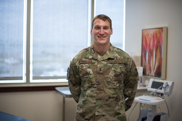 First Lt. Aaron O'Meara standing in medical exam room.