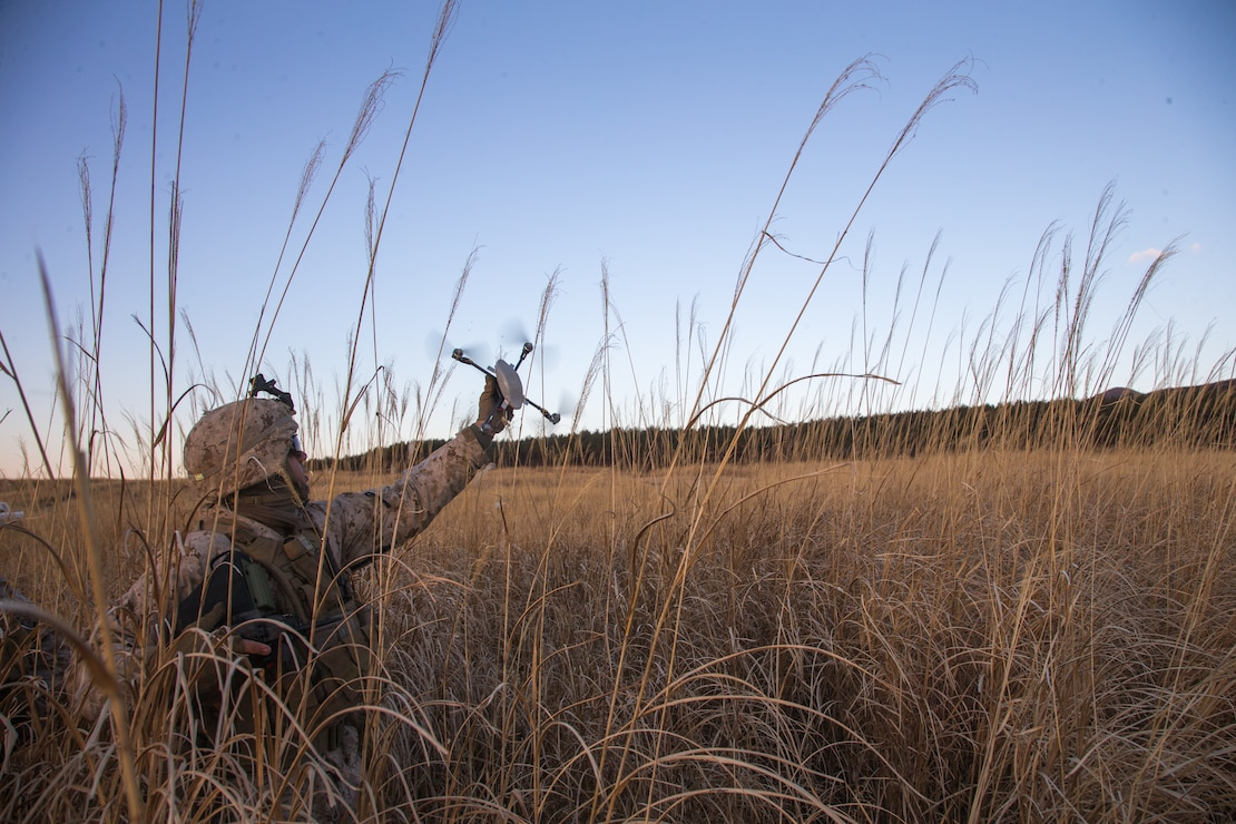 U.S. Marine Corps Lance Cpl. Braxton Lee, a rifleman with Kilo Company, 3rd Battalion, 8th Marine Regiment, utilizes a drone at Combined Arms Training Center, Camp Fuji, Japan on Jan. 22, 2021. Marines used drones to scan for enemy positions from the defense during Joint Exercise Littoral Strike, the culminating event for Fuji Viper 21.2. The exercise strengthened interoperability and challenged infantry formations, demonstrating that marines can facilitate joint force multi-domain maneuver in support of naval operations. 3/8 is forward-deployed in the Indo-Pacific under 4th Marine Regiment, 3rd Marine Division. Lee is a native of Florence, South Carolina.