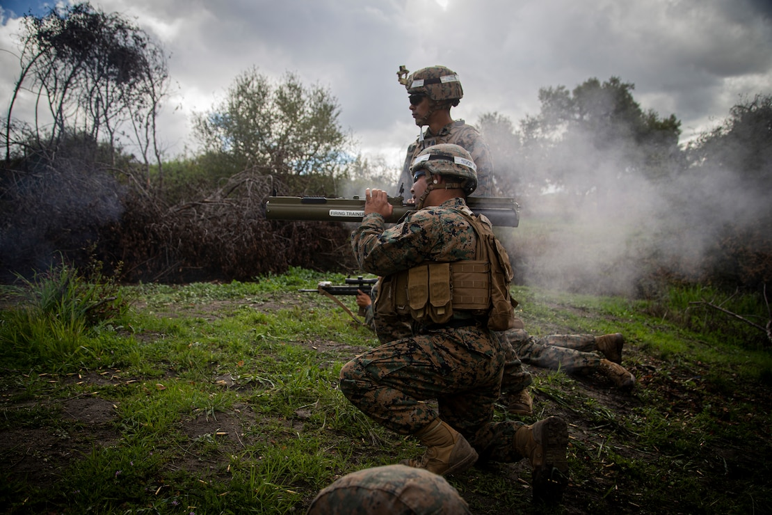 A U.S. Marine combat instructor with Alpha Company, Infantry Training Battalion, School of Infantry - West, fires an M72 light anti-tank weapon during fire and maneuver drills as part of the seventh week of the Infantry Marine Course on Marine Corps Base Camp Pendleton, Calif., March 11, 2021. IMC is a 14-week pilot course designed to create better trained and more lethal entry-level infantry Marines prepared for near-peer conflicts. The course uses a redesigned learning model for students intended to develop their capabilities for independent and adaptive thought and action. The program of instruction for IMC has been in development for a year and follows guidance from the 2019 Commandant's Planning Guidance and Force Design 2030.