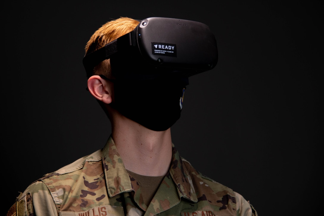 Airman 1st Class Zachary Willis, 22nd Wing Staff Agencies public affairs, experiences the headset used for virtual reality suicide prevention training April 15, 2021, at McConnell Air Force Base, Kansas. Air Mobility Command is the first in the Department of Defense to utilize VR for suicide prevention training.  (U.S. Air Force photo by Senior Airman Nilsa Garcia)