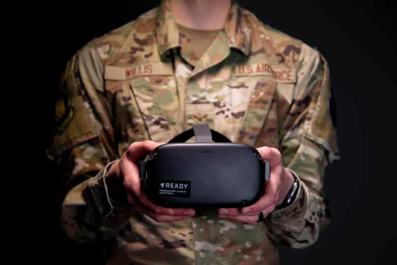 Airman 1st Class Zachary Willis, 22nd Wing Staff Agencies public affairs, holds the headset utilized for virtual reality suicide prevention training April 15, 2021, at McConnell Air Force Base, Kansas. The 30-minute training provides a fully immersive experience that involves Airmen wearing a headset and entering into a virtual training scenario where they interact with an Airman in distress. Currently, the VR training is approved to be one of four options Airmen can choose to fulfill their annual suicide prevention training.  (U.S. Air Force photo by Senior Airman Nilsa Garcia)