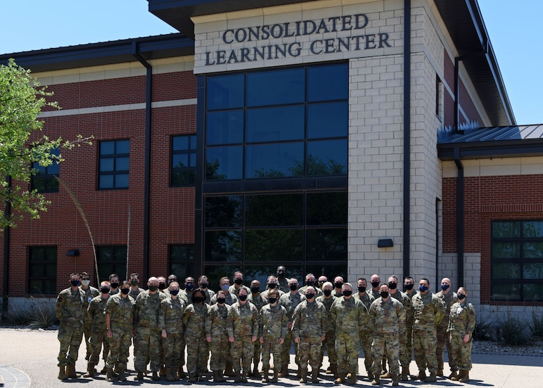 The Intelligence Functional Advisory Team pose with Goodfellow Air Force Base leadership in a photo at the Consolidated Learning Center on Goodfellow Air Force Base, Texas, April 23, 2021. The Intelligence FAC is a team who reviews the framework for the intelligence career field. (U.S. Air Force photo by Senior Airman Ethan Sherwood)