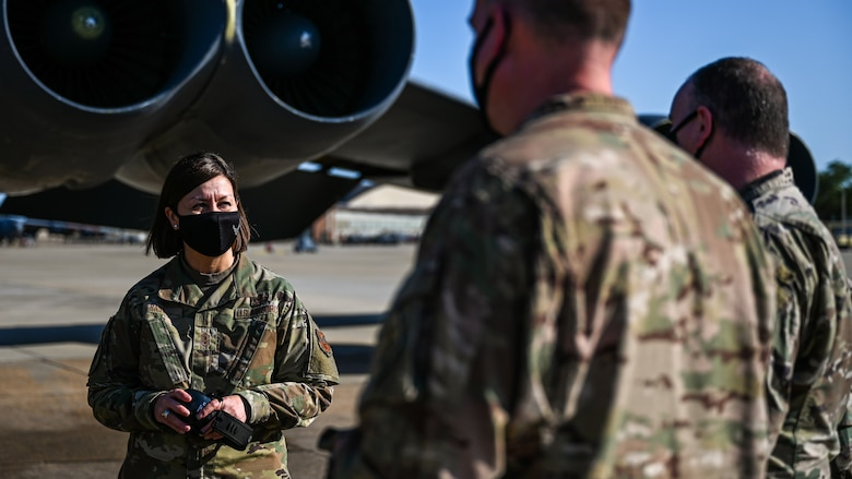 Chief Master Sgt. of the Air Force JoAnne S. Bass, speaks with members of the 2nd Aircraft Maintenance Squadron during a tour of Barksdale Air Force Base, Louisiana, April 21, 2021. During the tour, Bass familiarized herself with the mission of the 2nd Bomb Wing. (U.S. Air Force photo by Senior Airman Christina Graves)