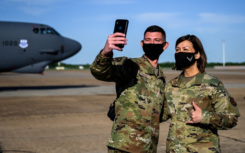 Chief Master Sgt. of the Air Force JoAnne S. Bass and Technical Sgt. Austin West, 2nd Aircraft Maintenance Squadron instrument flight control systems craftsman, pose for a selfie during a tour of Barksdale Air Force Base, Louisiana, April 21, 2021. West was recognized for being a master technician from the 96th Aircraft Maintenance Unit. (U.S. Air Force photo by Senior Airman Christina Graves)