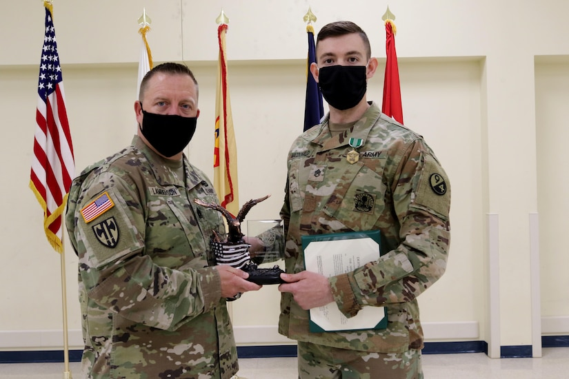 Command Sgt. Maj. James Lamberson (left) presents Staff Sgt. Trevor MacDonald the 80th Training Command's Best Warrior 2021 trophy on April 23, 2021 for his winning effort during the command's competition in Camp Bullis, Texas. MacDonald will now prepare for and compete in the U.S. Army Reserve competition against other winners from numerous geographic and functional commands in May 2021.