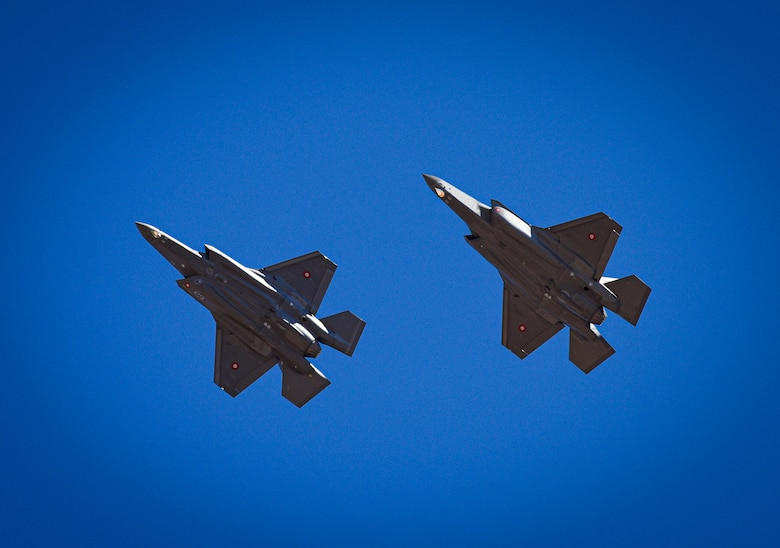 Two Royal Danish Air Force F-35A Lightning II fighter jets assigned to the 308th Fighter Squadron soar, April 13, 2021, over Luke Air Force Base, Arizona.