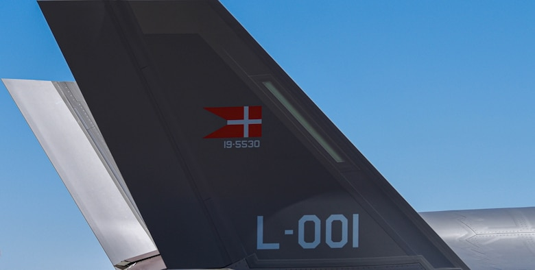 The Danish flag is represented on the tail of a Royal Danish Air Force F-35A Lightning II as the aircraft, assigned to the 308th Fighter Squadron, taxis on a runway April 13, 2021, at Luke Air Force Base, Arizona.