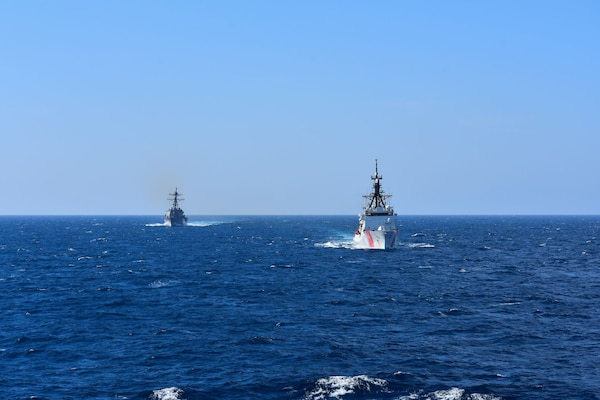 USS Roosevelt (DDG 80) and USCGC Hamilton (WMSL 753) conduct a series of passing and communication exercises, along with helicopter operations in the Mediterranean Sea, April 26, 2021.