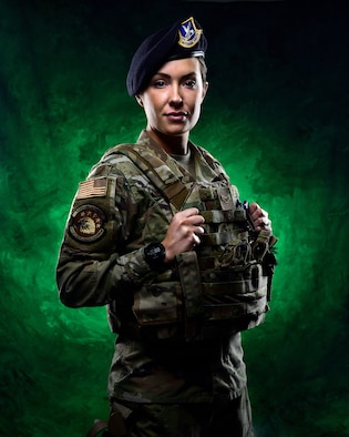 Airman 1st Class Leslie Ann Lindsay displays some of her 50th Security Forces Squadron gear during a shoot March 22, 2021 at Schriever Air Force Base, Colorado. After a stint with the NFL's Indianapolis Colts and the NBA's Indiana Pacers, Lindsay joined the Air Force and is currently with the 50th Security Forces Squadron. (Photo by Dennis Rogers)