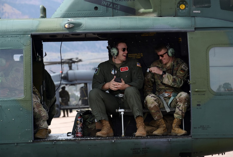 Cadets 2nd Class George Biery (left) and David Grey get ready to fly aboard a UH-1 H helicopter
