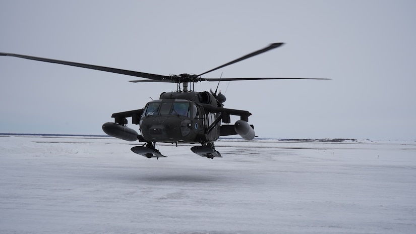 A UH-60 Black Hawk helicopter departs Bethel, Alaska, returning to Joint Base Elmendorf-Richardson, April 9, 2021, after providing transportation to hub villages April 7-9. Maj. Gen. Torrence Saxe, commissioner for the Alaska Department of Military and Veterans Affairs and adjutant general for the Alaska National Guard, accompanied by representatives from the Department of Environmental Conservation and the Department of Commerce, Community, and Economic Development, traveled to Western Alaska to meet with Tribal leaders and citizens in Bethel, Tuluksak, and Chevak. They discussed disaster assistance measures and processes in light of recent emergencies that have occurred in the region, and in preparation for the upcoming flood season. (U.S. Army National Guard photo by Dana Rosso)