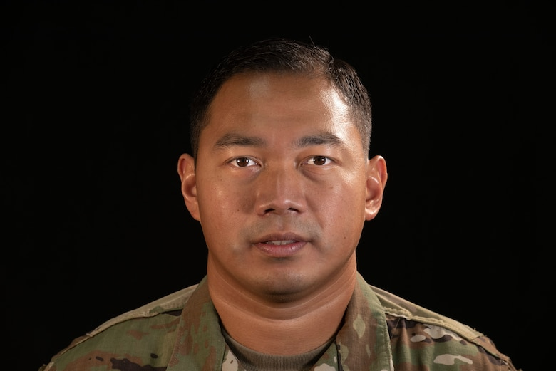 Tech. Sgt. Leo Mangahas, 664th Combat Communication Squadron NCO in charge of quality assurance, poses for a photo at Andersen Air Force Base, Guam, March 16, 2021.