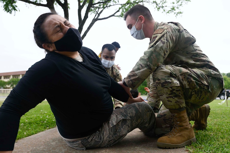 Photo of Airman taking part in a simulated casualty exercise.