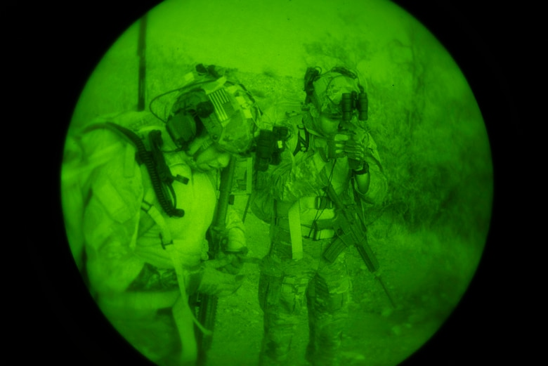 Two U.S. Air Force Tactical Air Control Party specialists check their compass during the 2021 Wraith Challenge, April 21, 2021, at Chuck Heinrich Memorial Park, Texas. There were two portions to the land navigation test, a day test and a night test. (U.S. Air Force photo by Airman 1st Class Jessica Sanchez)