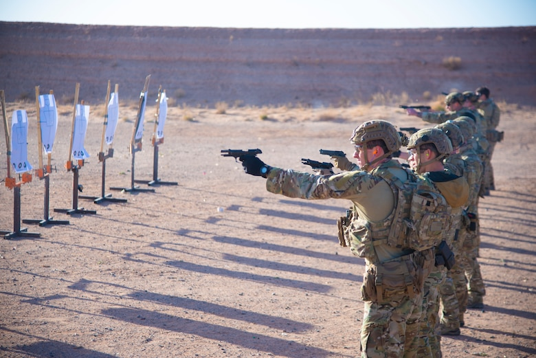 U.S. Air Force Tactical Air Control Party specialists shoot a Beretta M-9 during the 2021 Wraith Challenge, April 21, 2021, on Fort Bliss Rod and Gun Club, Texas. The TACP specialists went through the Navy qualification course of fire to test their firing ability in nonstandard positions. (U.S. Air Force photo by Airman 1st Class Jessica Sanchez)
