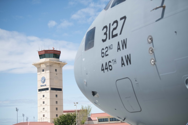 A C-17 aircraft flies upward over Travis AFB, Calif.