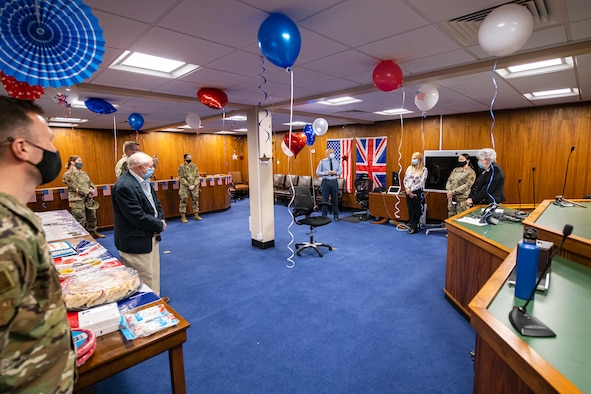 The 501st Combat Support Wing judge advocate office hosts a celebration for Valerie Lucas, right, 501st CSW British liaison officer, at RAF Alconbury, England, April 23, 2021. The 501 CSW/JA office celebrated Mrs. Lucas for her 60 years of service as the British liaison officer at RAF Alconbury. (U.S. Air Force photo by Senior Airman Eugene Oliver)
