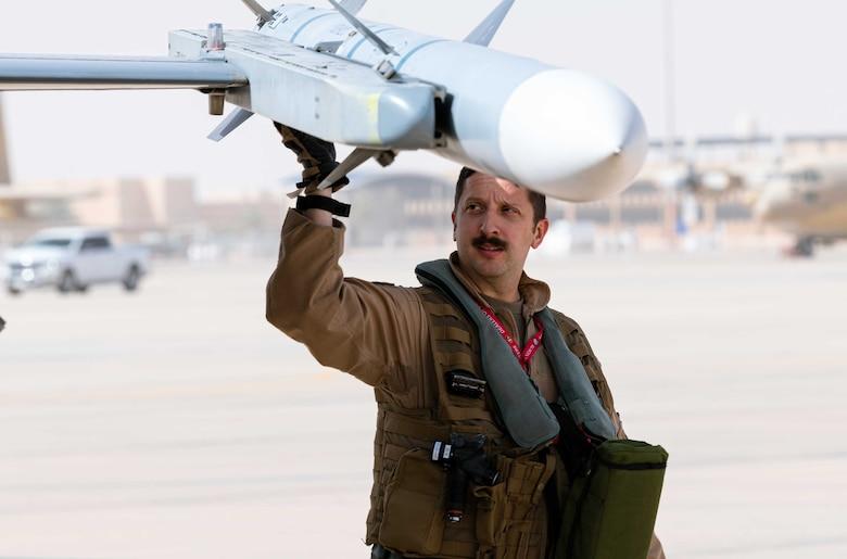 Photo of a pilot inspecting an aircraft