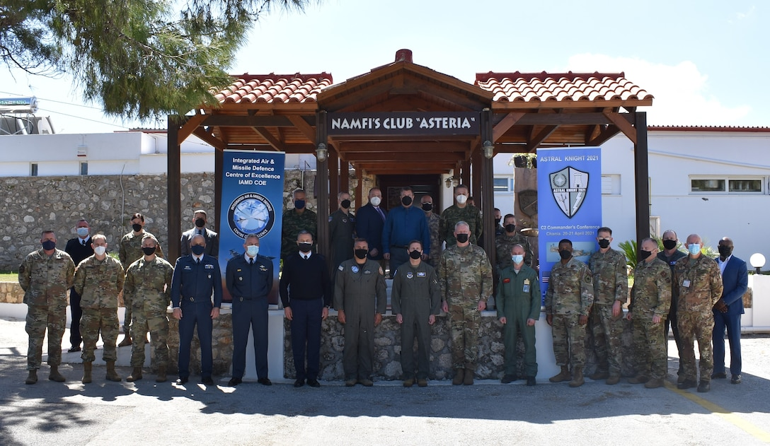 Participants of the Command and Control Commanders Conference pose for a group photo at the NATO Air and Missile Firing Installation conference center in Chania, Crete on April 21, 2021. Commanders from six NATO nations attended the two-day conference to discuss IAMD coordination in the southern European region, in preparation for the upcoming USAFE-AFAFRICA-led exercise, AK21.