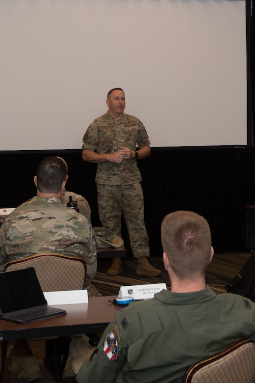 Chief Master Sgt Jeremy Malcom speaks with Tenth Air Force unit commanders, discussing his interaction with unit chiefs and answering questions about the enlisted force.
