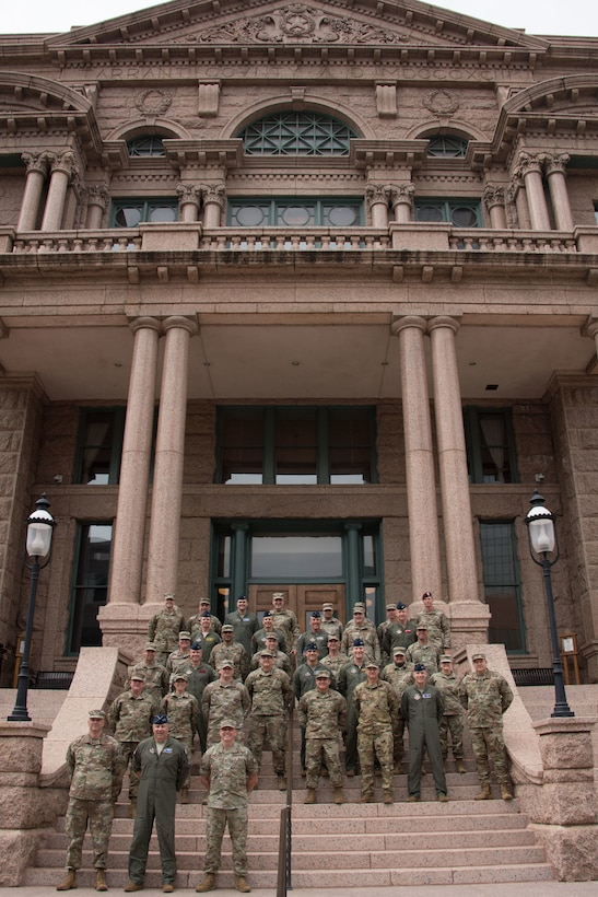 Members of 10th Air Force took a break during the 2021 Commanders and Command Chiefs Conference to take a photo in front of the Fort Worth Courthouse.
