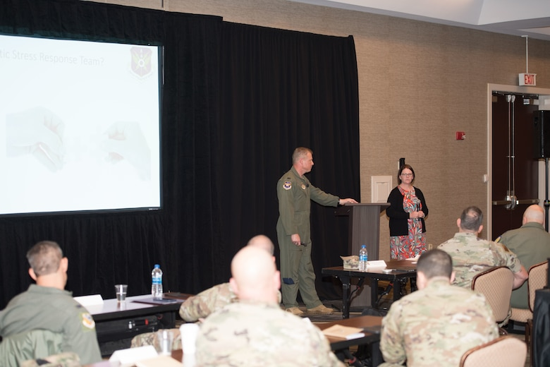 Colonel Allen Duckworth, 301st Fighter Wing Commander, and Ms. Mary Arnold, 301st Fighter Wing Director of Psychological Health, discuss the Traumatic Stress Response Team during the 10th Air Force Commanders and Command Chiefs Conference in Downtown Fort Worth.
