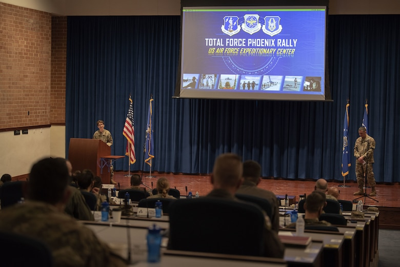 U.S. Air Force Gen. Jacqueline Van Ovost, Air Mobility Command commander, gives opening remarks with U.S. Air Force Chief Master Sgt. Brian Kruzelnick, AMC command chief, during Total Force Phoenix Rally, April 20, 2021, at the U.S. Air Force Expeditionary Center headquarters on Joint Base McGuire-Dix-Lakehurst, New Jersey. The event allows leadership across the Total Force Mobility Air Forces to discuss their perspectives and how they support AMC's priorities: develop the force, advance warfighting capabilities, project the joint force and ensure strategic deterrence. (U.S. Air Force photo by Master Sgt. Ashley Hyatt)