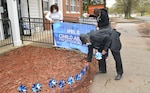 Staff members of the Fort Lee Family Advocacy Program set up signage and their annual pinwheel garden display by the front entrance of the Army Community Service facility to mark the start of Child Abuse Prevention Month on April 1. Pictured from left are FAP Specialist LaKetia Jones and New Parent Support Program Specialists Georgette Nelson and Teresa Mitchell. (U.S. Army Photo by Patrick Buffett)