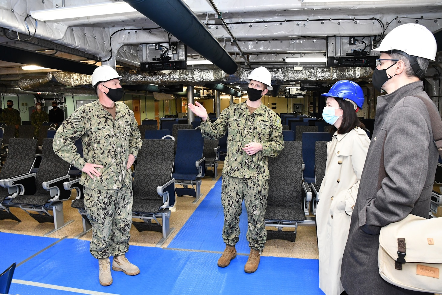 Cmdr. TJ Seifert, officer in charge of USNS Carson City, gives a tour to VADM Gene Black, Ms. Victoria Taylor, Charge d'Affaires, and Mr. Mark Schapiro, COMUSNAVEUR Political Advisor, during their visit to Rijeka, Croatia.