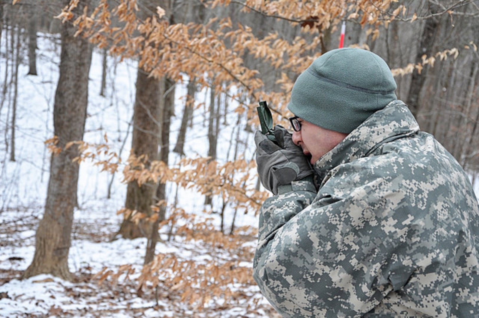 Officer candidates from Class 57 of the Virginia National Guard's Officer Candidate School conduct land navigation training Jan. 25, 2014, at Fort Pickett, Va., during the Zero Phase of the course. For many of the candidates, this was their first drill with the OCS program. (Photo by Staff Sgt. Terra C. Gatti, Virginia Guard Public Affairs)