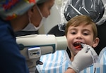 Dental technician conducts an X-ray on child patient