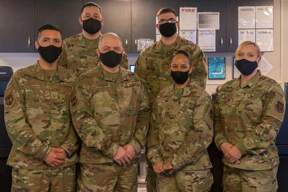 The 403rd Wing Command Post team: (back left to right) Tech. Sgt. Marvin Mercado, Staff Sgt. William Garrett, (front left to right) Master Sgt. Carlos Ramirez, Senior Master Sgt. Brian Harms, Master Sgt. Desirae McIntyre, and Master Sgt. Shawna Smith, pose for a photo at Keesler Air Force Base, Miss., April 11, 2021. The command post manages and performs a multitude of command and control operations that depending on the call they receive, can vary from minor issues to major incidents. (U.S. Air Force photo by 2nd Lt. Christopher Carranza)