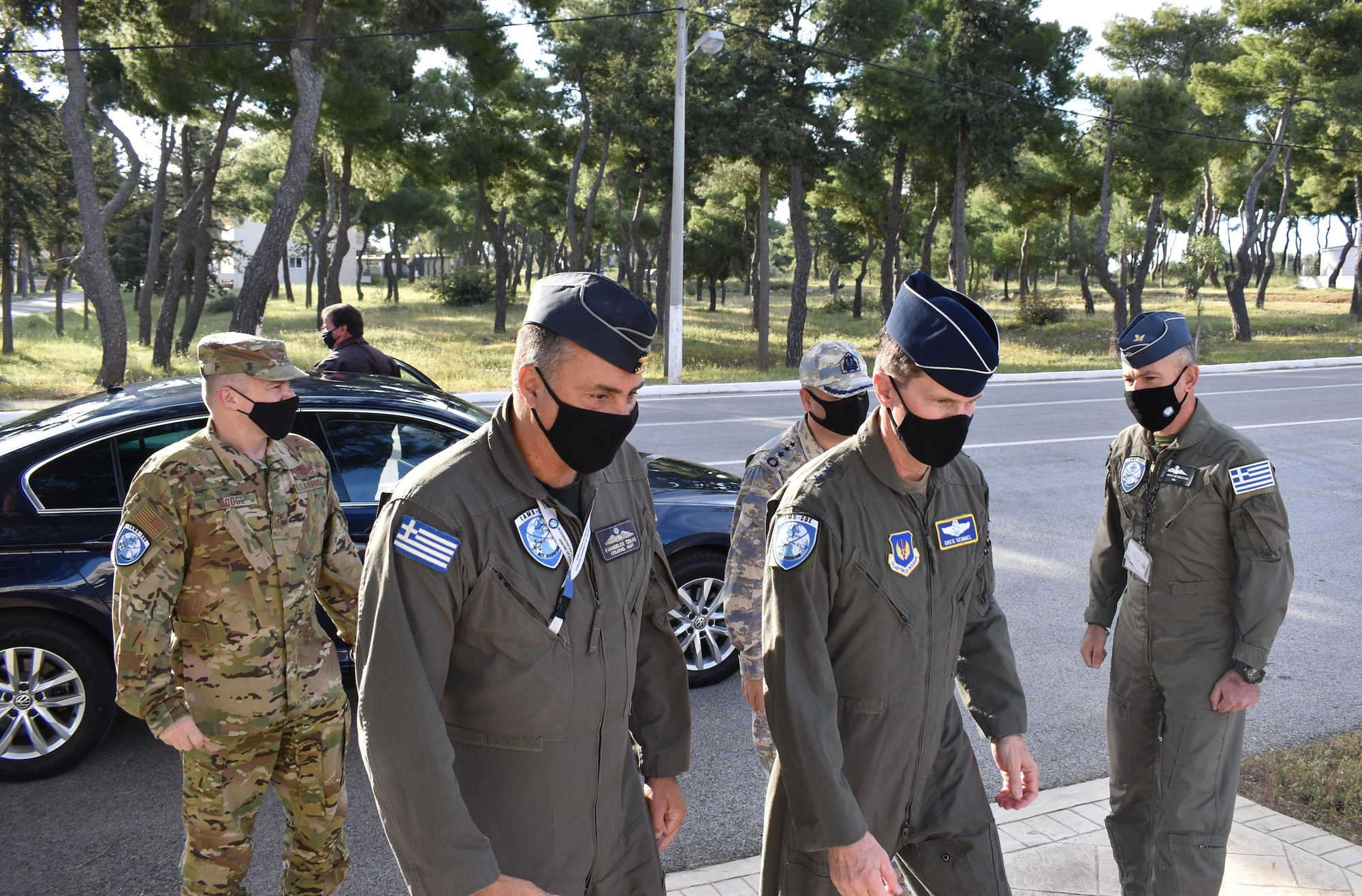 Hellenic Air Force Col. Evangelos Tzikas (left) walks U.S. Air Force Maj. Gen. Greg Semmel (right) into the newly formed Integrated Air and Missile Defense Center of Excellence for a facility tour in Chania, Crete on April 21, 2021. The IAMD COE was recently approved as a multinational COE where subject matter experts from five nations collaborate thoughts and inputs for the IAMD domain.
