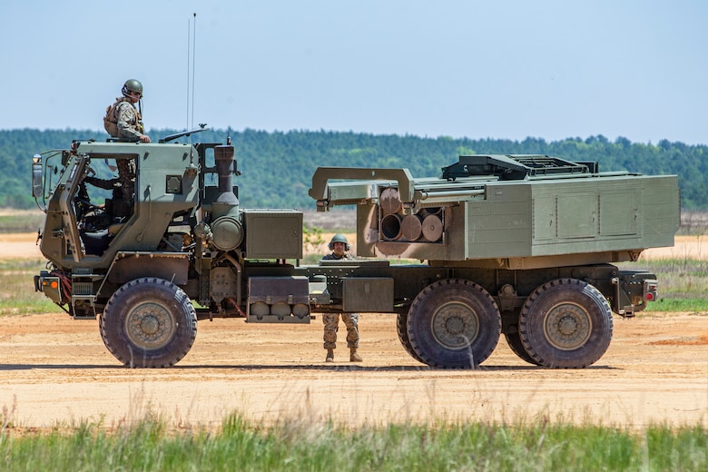 U.S. Marines with 1st Battalion, 10th Marine Regiment, 2d Marine Division (2d MARDIV), load a High Mobility Artillery Rocket System (HIMARS) with 227mm rockets during Exercise Rolling Thunder 21.2 on Fort Bragg, N.C., April 26, 2021. This is a live-fire artillery exercise where 10th Marines employed distributed fires via simulated Expeditionary Advanced Bases (EAB's). The training increased 2d MARDIV's combat readiness against a peer competitor. HIMARS are an advanced long-range and mobile rocket system that allows 2d MARDIV to employ precision fires onto a target. (U.S. Marine Corps photo by Pfc. Sarah Pysher)