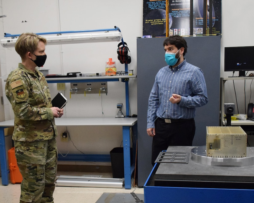 Mr. Chris Lomanno, research engineer, discusses AFIT's vibration table with Brig. Gen. Linell Letendre, dean of faculty, USAFA.  AFIT's Center for Space Research and Assurance focuses on the evolution of defense and intelligence missions in space.