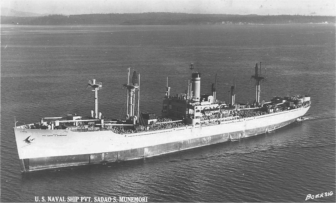 A large ship floats on the water.